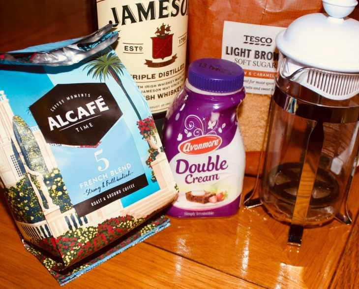 The four ingredients to the best Irish coffee. Good whiskey and coffee, brown sugar and freshly whipped cream.