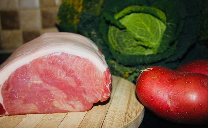 Back bacon, savoy cabbage and red potatoes before preparation. Beautiful fresh produce.