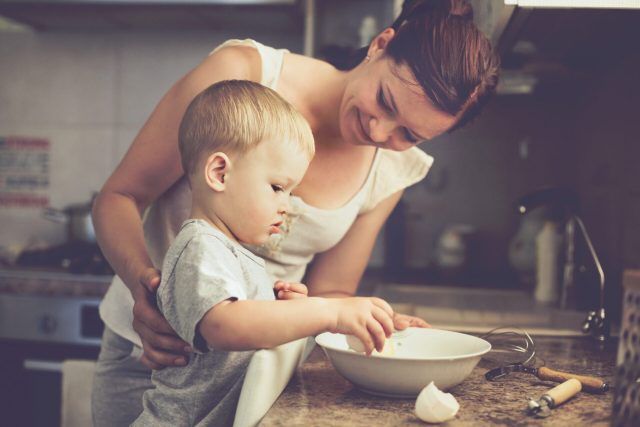 toddler cooking with mother