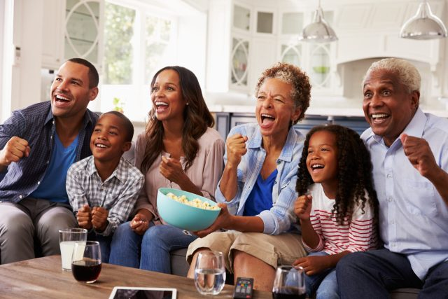 a family enjoying tv together, enjoying screen time with kids