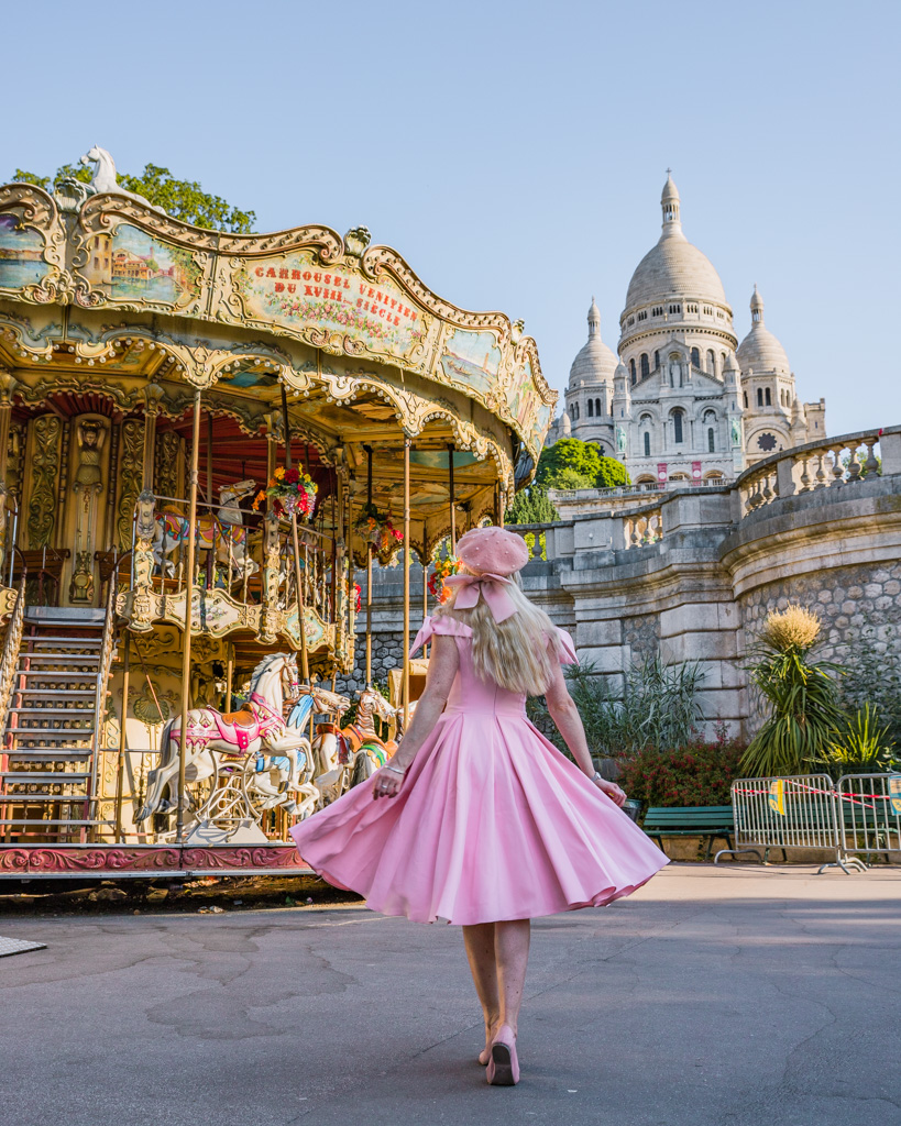 Carousel in Square Louise Michel with a view of the Sacré-Coeur - Montmartre in Paris