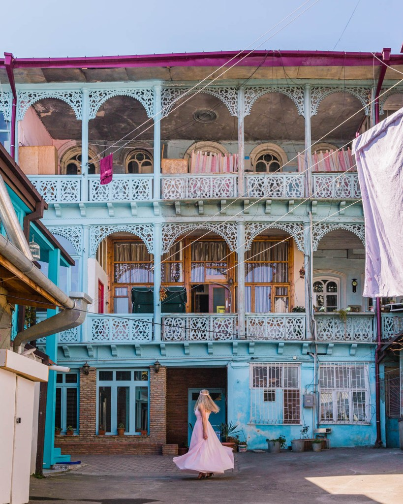 Pastel house with carved wooden balconies in the Old Town of Tbilisi - Georgia