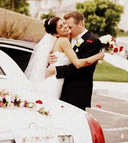 Image of couple standing by a CT Limo