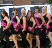 Picture of girls posing in front of escalade limo