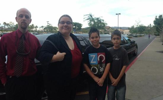 Family celebrating adoption finalization w/ Orange County limousine service.