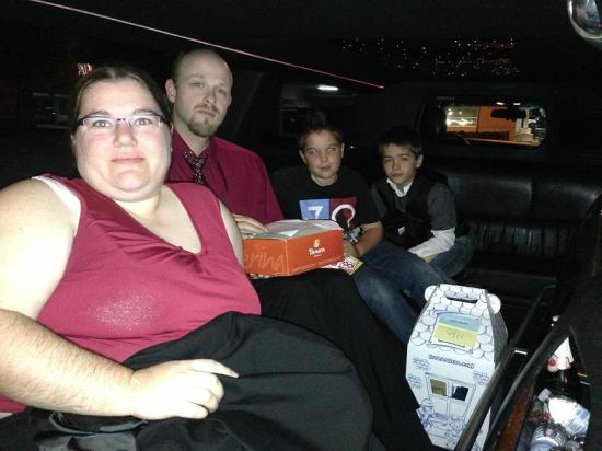 Family in black stretch Lincoln Town Car limousine in Orange County, CA.