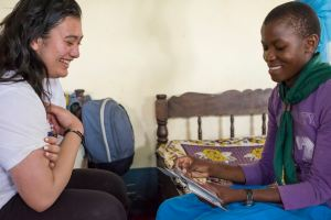 Samina showing some pictures to a student at Kinanga School for the Deaf, Kenya.