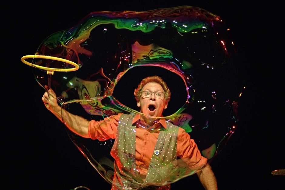 The Amazing Bubble Man creating a extremely large soap bubble