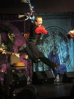 Molly's Revenge trio jumping during a WinterDance performance