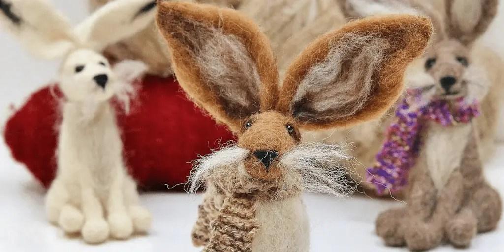 three needle felted hares