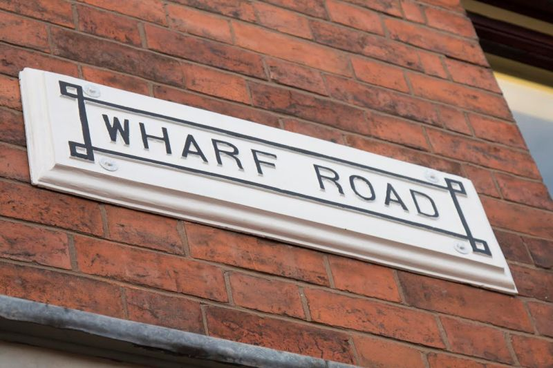 The refurbished Wharf Road sign.