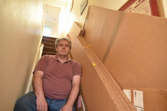 Boxes and doors have been left all over the house and Neil Richardson is still trying to have them removed.