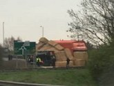 Lorry overturns causing delays on A1