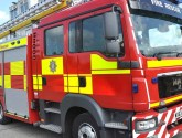 Firefighters cut casualty out of car after crash