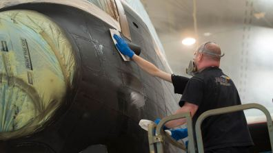The Paint team preparing Just Jane to be painted Photo: Steve Smailes