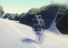 """Idiot"" wheelie motorcyclist whizzes past dash cam"