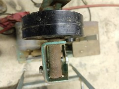 Close up of as found top idler pulley showing the belt tracking adjusting mechanism