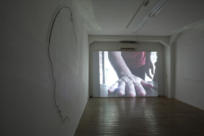 Christmas Present, 2011, Digital video projection. For My Nephew Robert, 2011, shoelaces, pins.