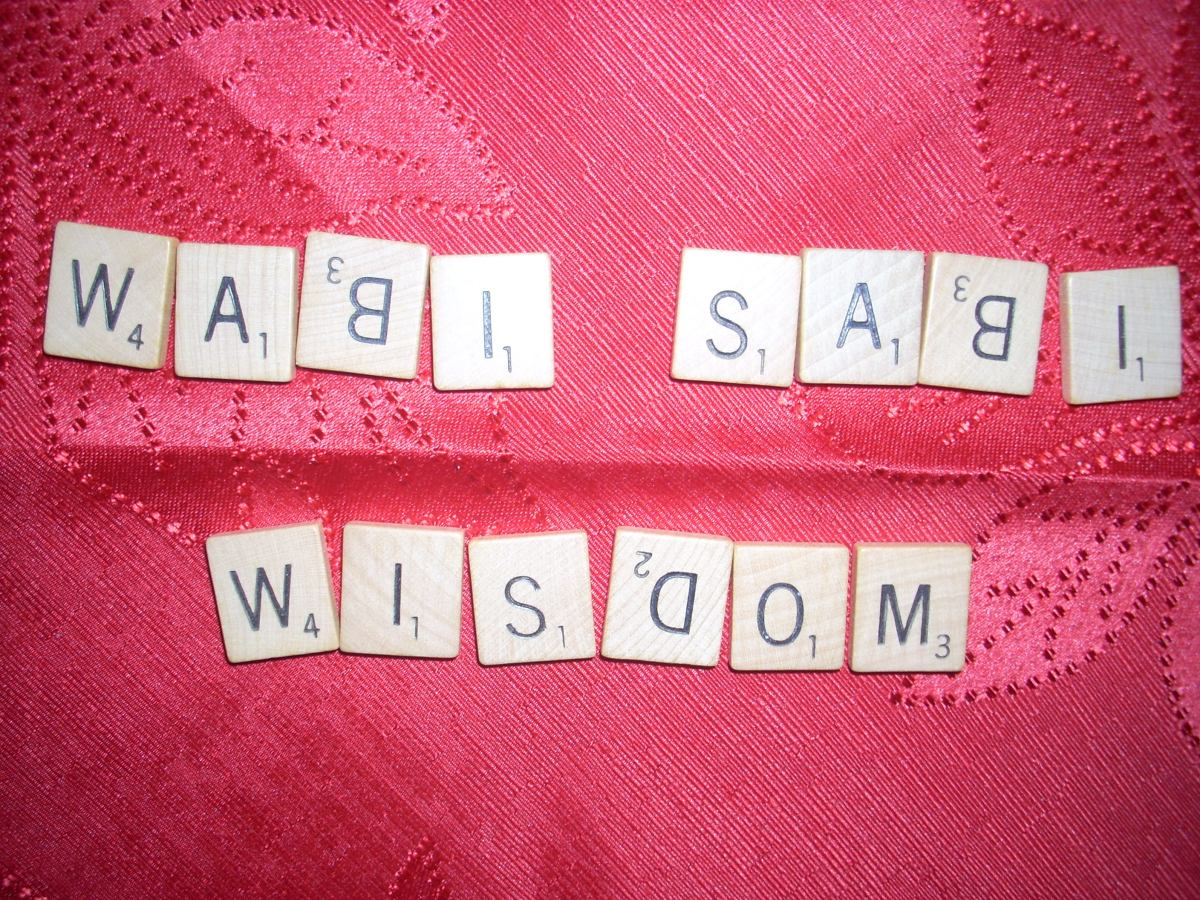 """The words """"wabi sabi wisdom"""" imperfectly have the letters B and D upside down!"""
