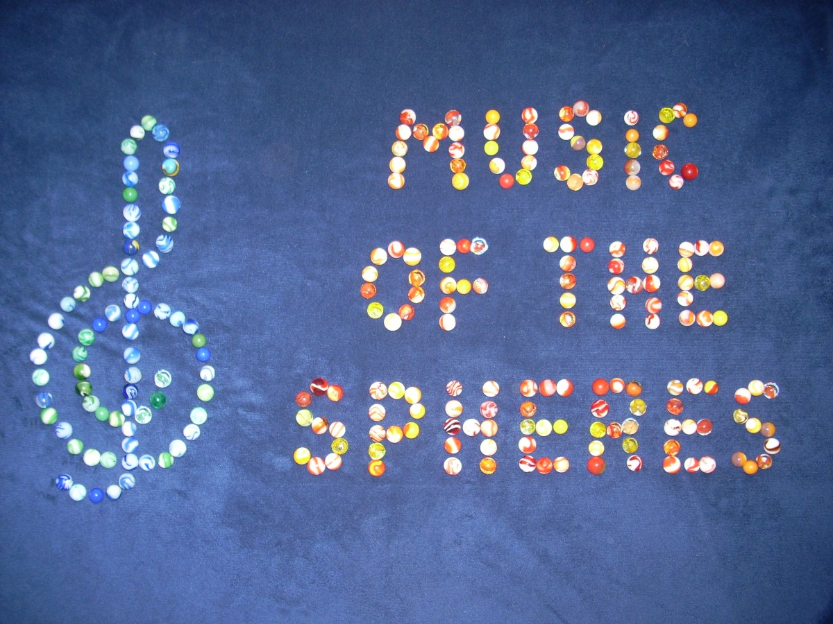 The title, Music of the Spheres as well as the treble clef symbol are represented with spherical marbles!