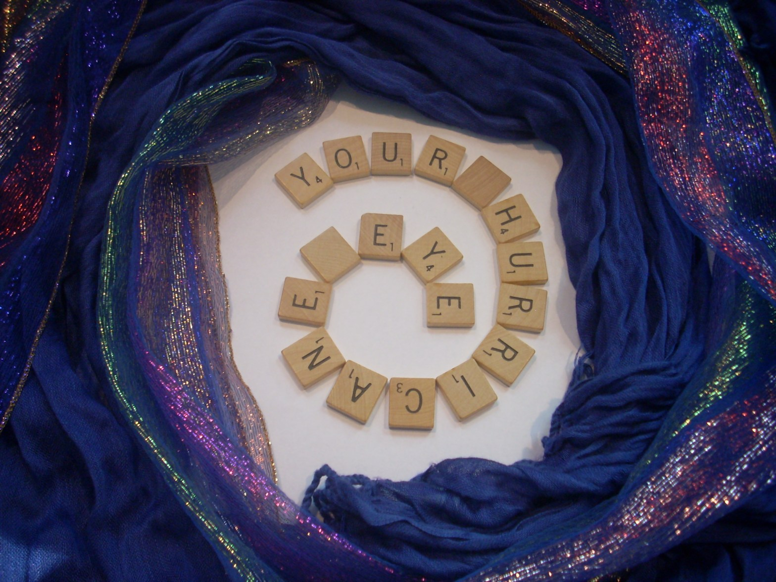 Title in Scrabble Tiles: Your Hurricane Eye, positioned in a circular formation as a hurricane