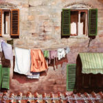 """Travels Collection : Hanging Out in Town, Watercolor painting of laundry hanging outside the window of a home in an Italian city by Linda Abblett. Original 22"""" x 15"""" $900; giclee 20 x 15"""" $130"""