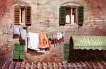 "Travels Collection : Hanging Out in Town, Watercolor painting of laundry hanging outside the window of a home in an Italian city by Linda Abblett. Original 22"" x 15"" $900; giclee 20 x 15"" $130"