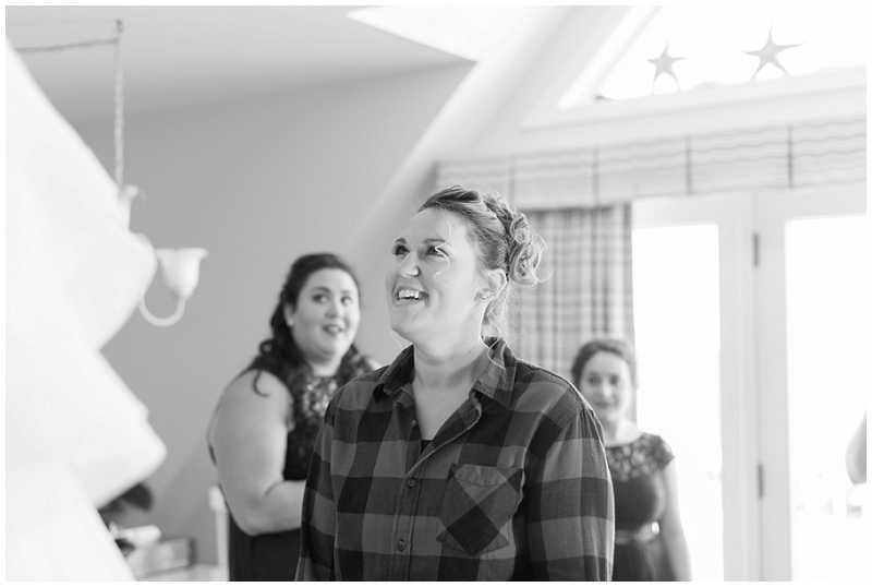 Melanie and Mike were married at Clay Hill Farm in Cape Neddick Maine. Click here to see more beautiful photos by Linda Barry Photography of their burgandy and navy wedding day! Bride looking at her dress.