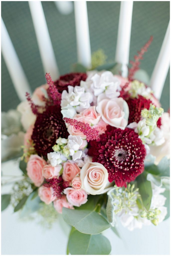Melanie and Mike were married at Clay Hill Farm in Cape Neddick Maine. Click here to see more beautiful photos by Linda Barry Photography of their burgandy and navy wedding day! Burgandy and blush floral arrangement for bridal bouquet