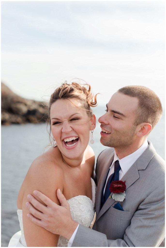 Melanie and Mike were married at Clay Hill Farm in Cape Neddick Maine. Click here to see more beautiful photos by Linda Barry Photography of their burgandy and navy wedding day! Bride and groom photos at Nubble Lighthouse.