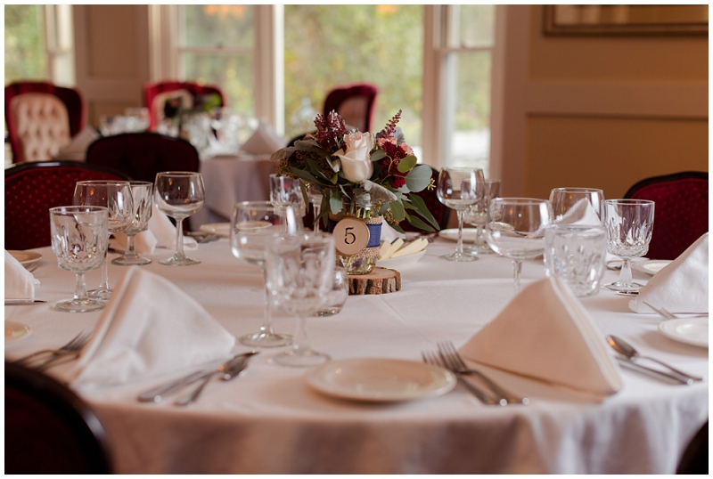 Melanie and Mike were married at Clay Hill Farm in Cape Neddick Maine. Click here to see more beautiful photos by Linda Barry Photography of their burgandy and navy wedding day! Wedding table centerpieces.