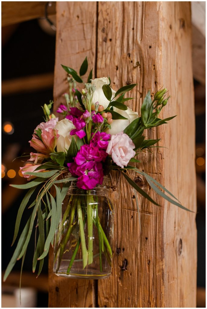 Emily and Nick were married at Stone Mountain Arts Center. Click here to see more wedding images by Linda Barry Photography. Floral reception decor.