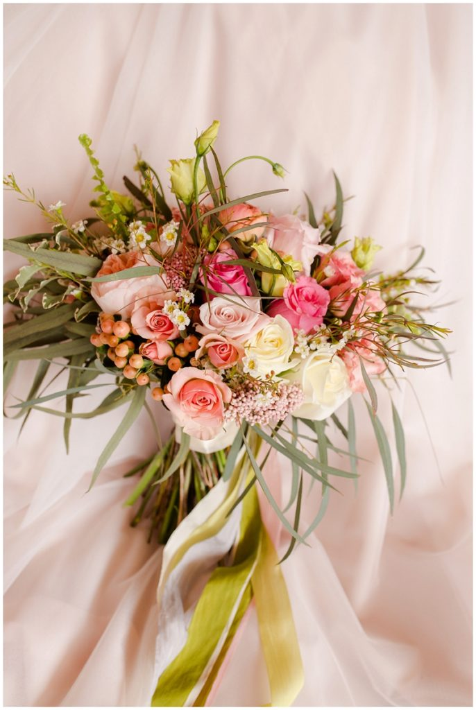 Emily and Nick were married at Stone Mountain Arts Center. Click here to see more wedding images by Linda Barry Photography. Peach and pink florals.