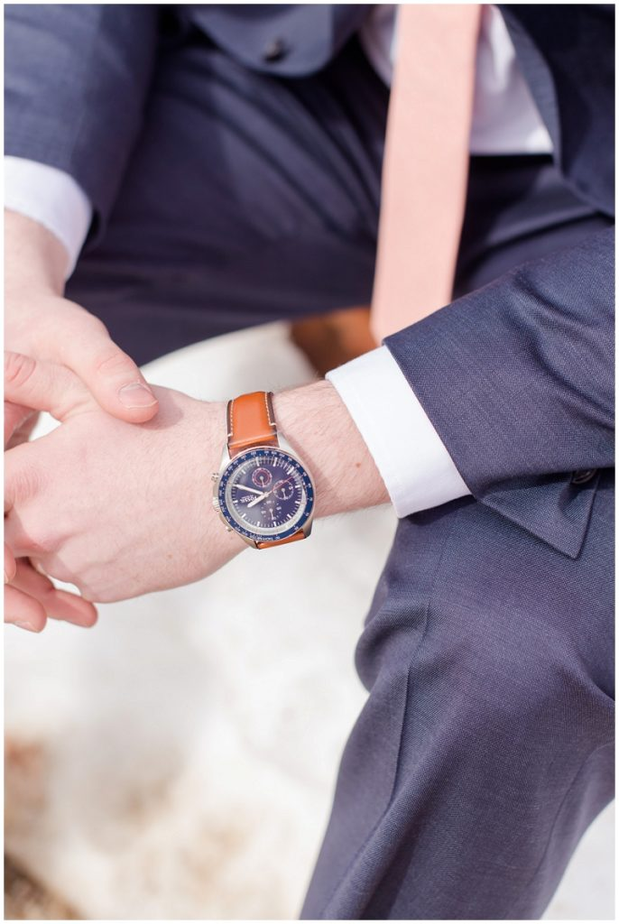 Emily and Nick were married at Stone Mountain Arts Center. Click here to see more wedding images by Linda Barry Photography. Groom fossil watch.