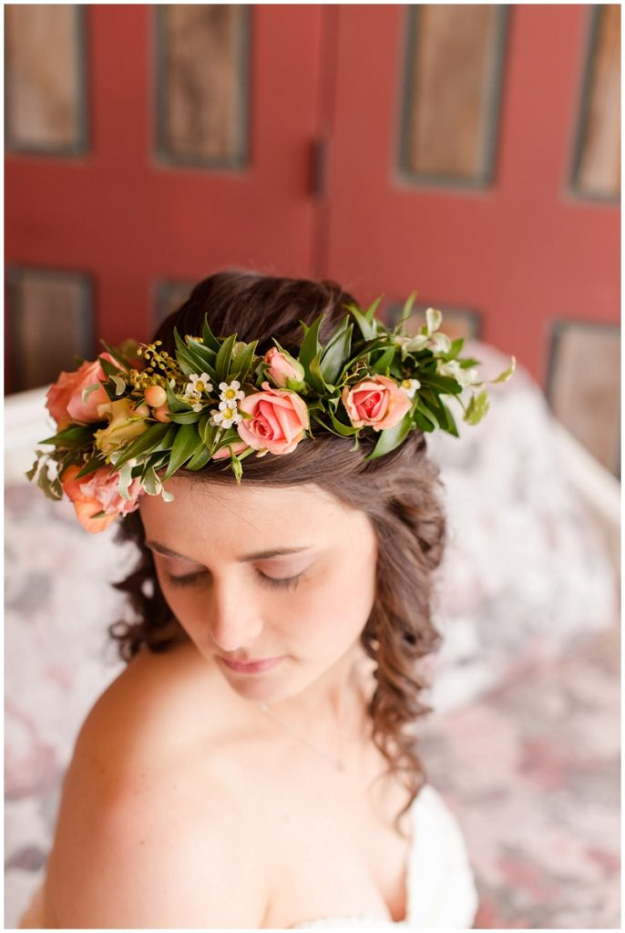 Emily and Nick were married at Stone Mountain Arts Center. Click here to see more wedding images by Linda Barry Photography. Bride wearing a flower crown.
