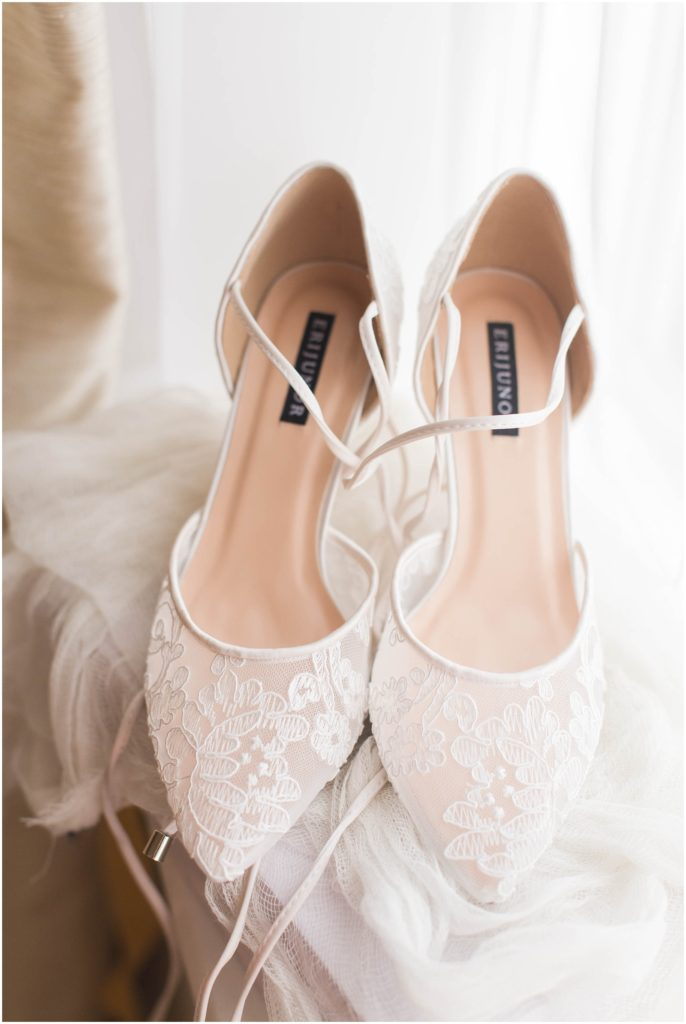 Elegant bridal shoes made of lace. The commons 1854 Styled wedding photos.