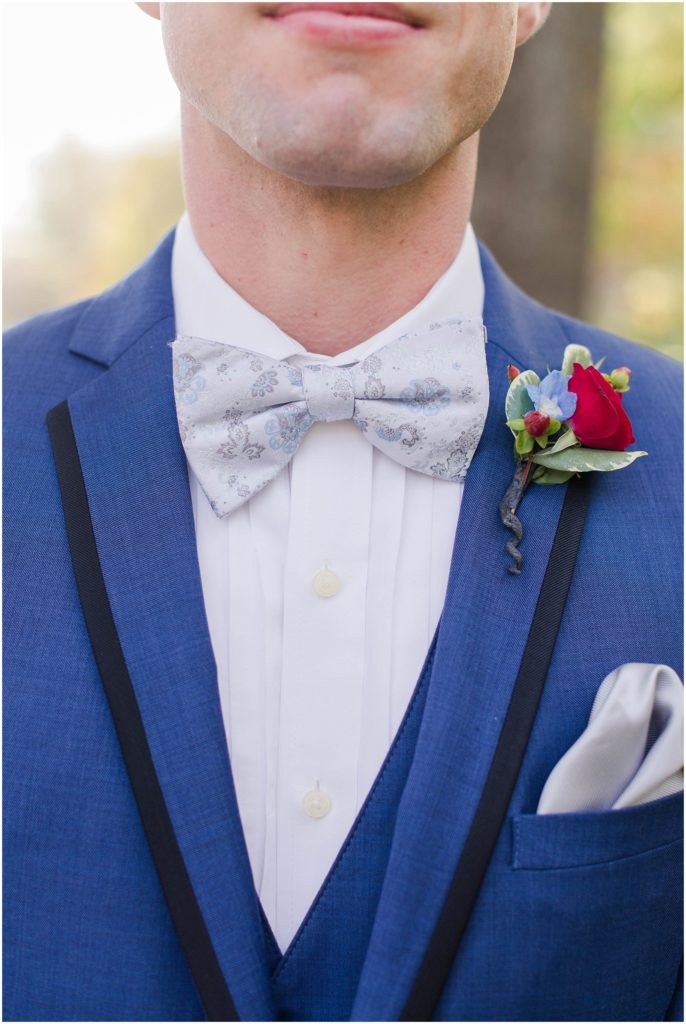 close up of the groom's tie and boutonniere