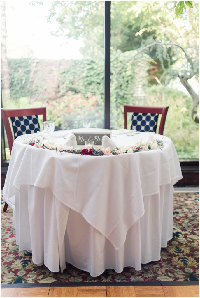 sweetheart table at this wedding at the Dan'l Webster Inn in Sandwich MA.
