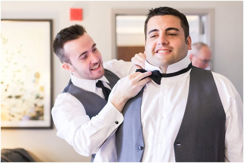 groom getting ready at the Westin in Portland ME.