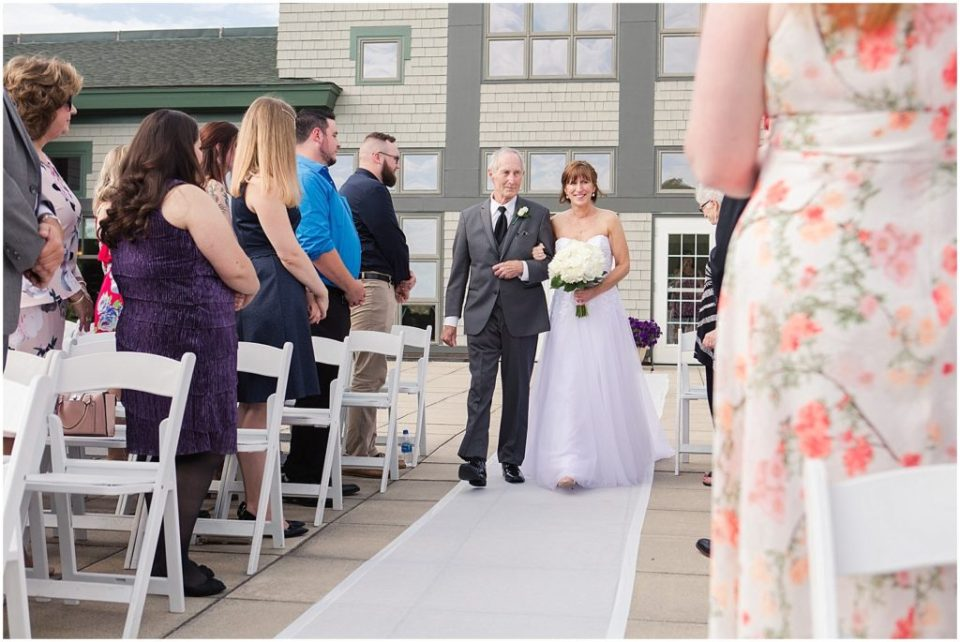 Outdoor ceremony at this summer wedding at the Woodlands Club.