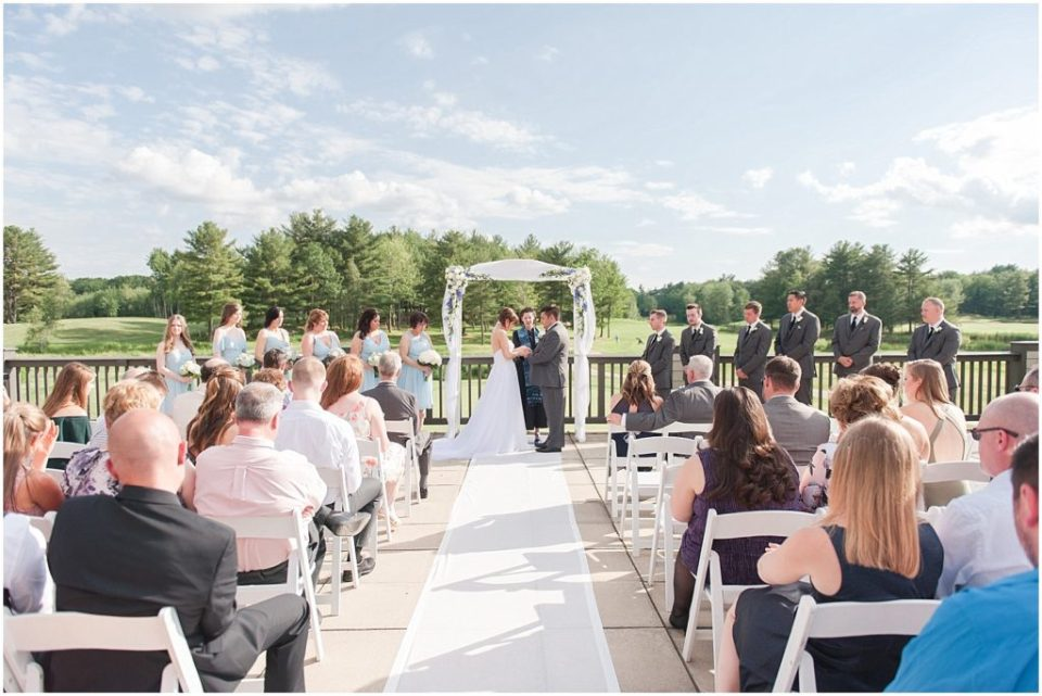 wide shot of the ceremony venue at the woodlands club.