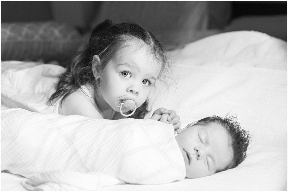 Boston lifestyle newborn photos taken inside with the big sister.