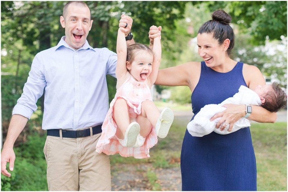 Family walking photo during their Boston lifestyle newborn photos.