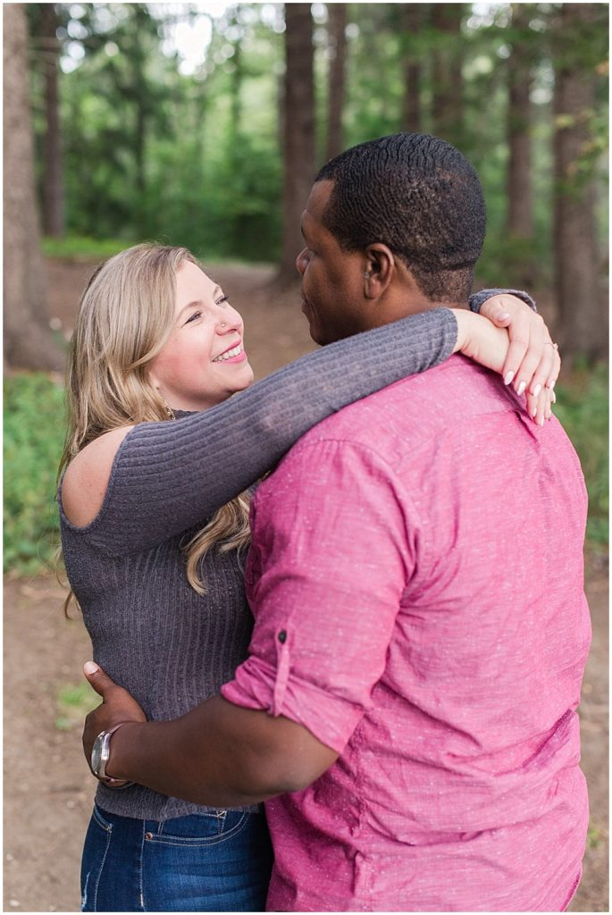Mykayla and Sean wearing casual outfits for their Mackworth Island engagement session.