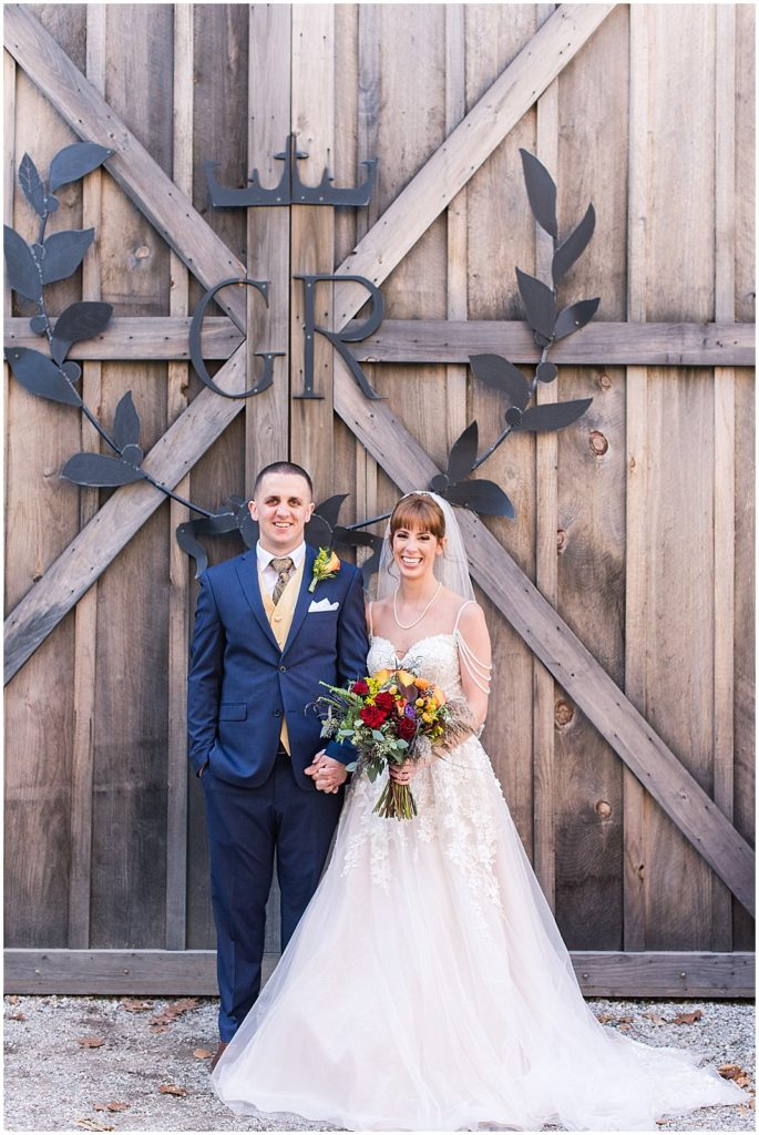 Caitlin and Liam in front of the barn at Granite Ridge Estate.