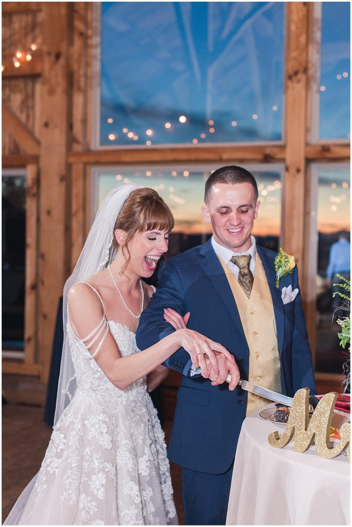 Cutting a cannoli instead of a cake at this Granite Ridge Estate and Barn wedding!
