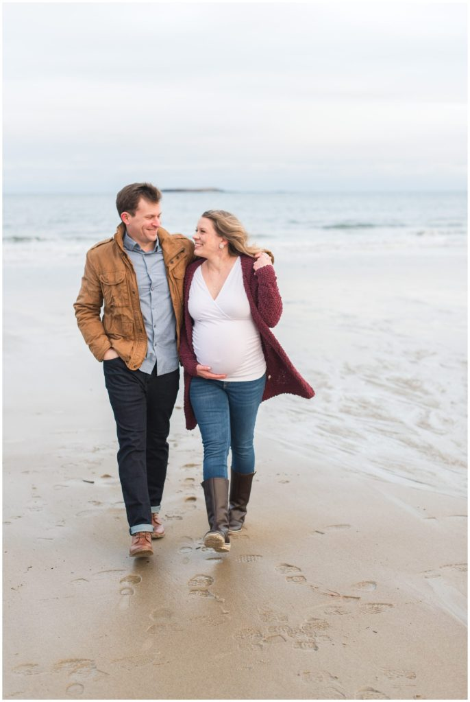 Erica and Shawn walking away from the ocean for their Ocean Park maternity photos.