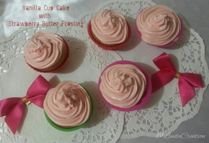 Vanilla Cupcakes with Strawberry Butter Frosting