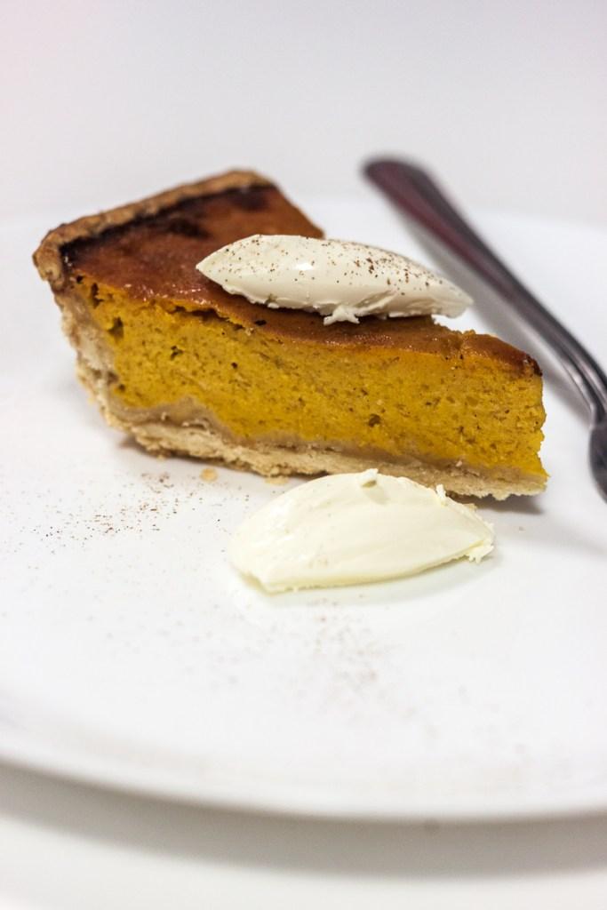 pumpkin pie with cinnamon and cream