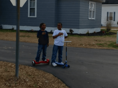 Photo of boys stopping to recite Pledge of Allegiance as flag is raised at fire department goes viral